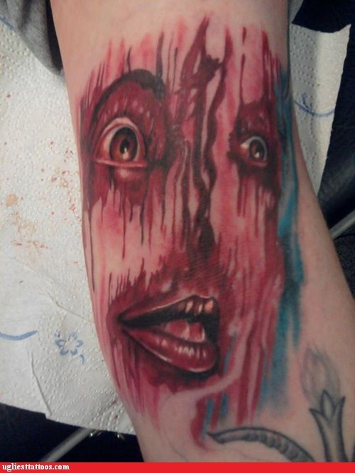 good god,murder eyes,still scary,well drawn tattoos