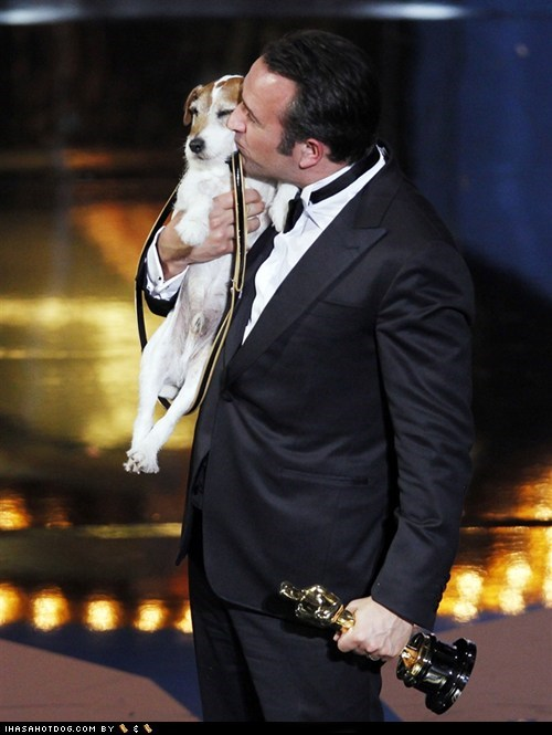 academy awards,celeb,famous,jack russell terrier,jean dujardin,KISS,kisses,oscars,oscars 2012,uggie,uggie the dog