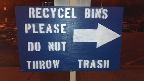 recycle bin sign throw trash