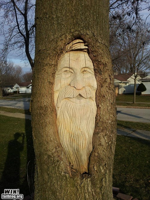 carving face sculpture tree