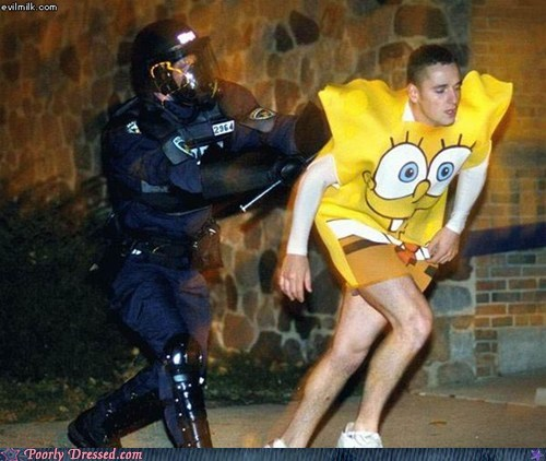 beating,costume,police,protestor,runner,SpongeBob SquarePants