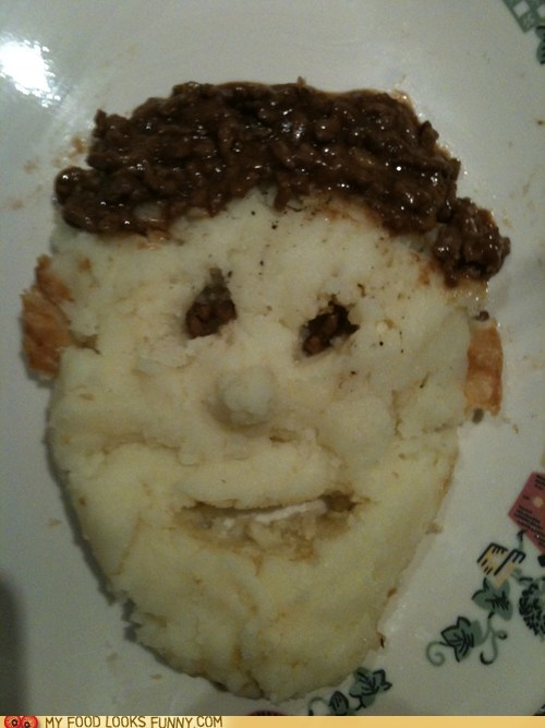 face,hair,mashed potatoes,meat pie,plate