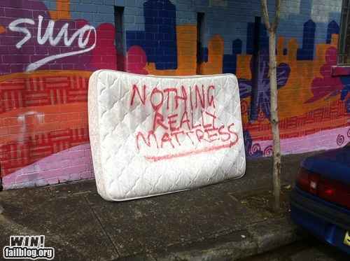 graffiti,mattress,queen,trash,word play
