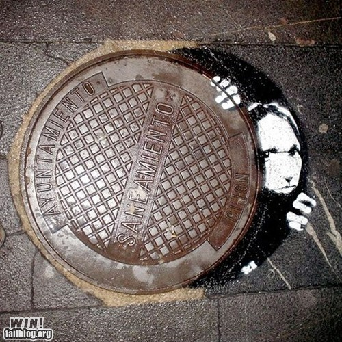cover graffiti hacked irl manhole Street Art - 6032375040