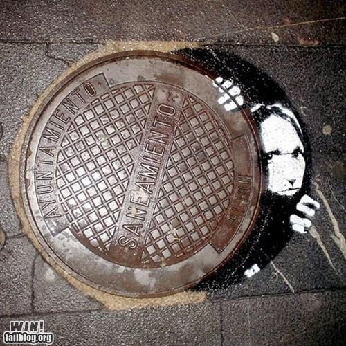 cover graffiti hacked irl manhole Street Art - 6032375040