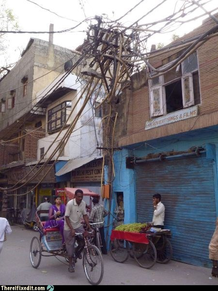 bike,india,tangled,telephone pole,wires