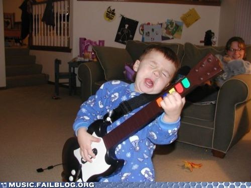 child,f,Guitar Hero,parenting