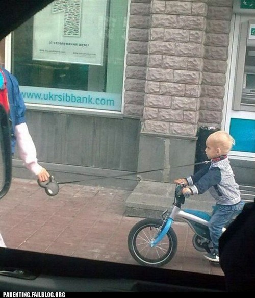 kid on a leash,leash,tricycle