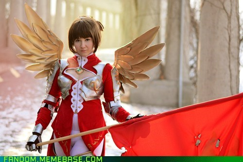 cosplay of ninety nine nights video game character inphyy woman in a red and white armor and golden wings