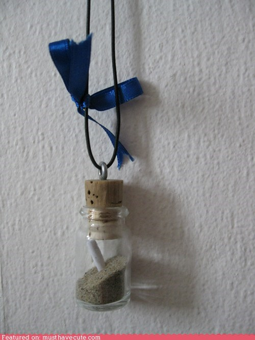 bottle,cord,cork,message,necklace,paper,sand