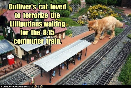 Cats,giant,gullivers-travels,lilliputians,model train,models,terrorize,terrorizing,trains