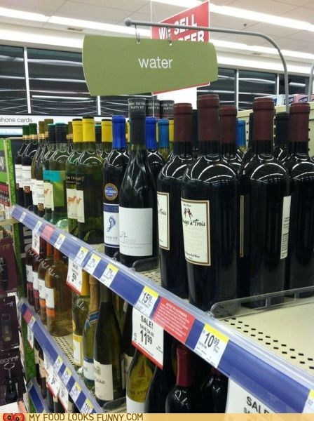 organized,shelves,sign,store,water,wine