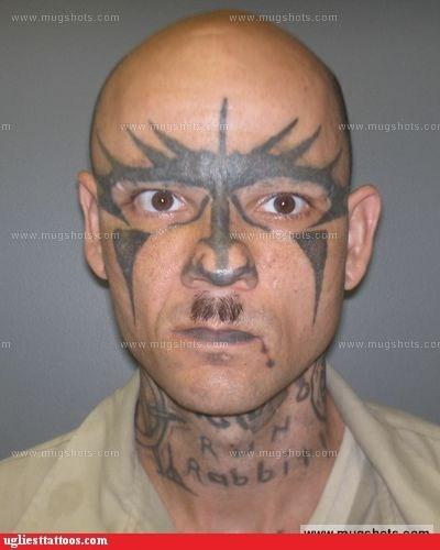 face tattoos,hitler mustache,mugshot