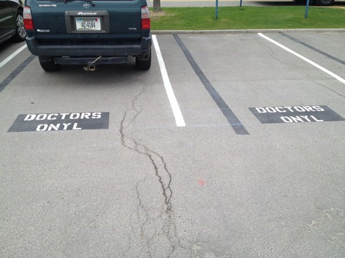 doctors only,misspelled,paint,parking lot