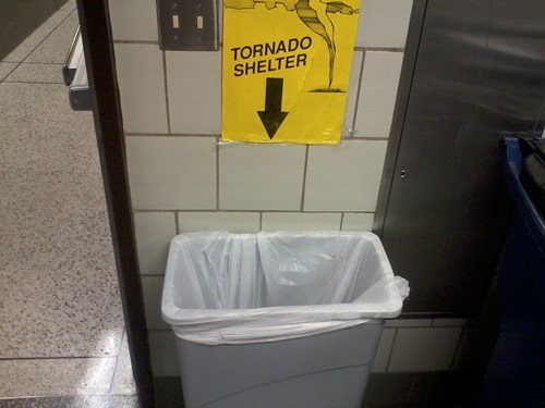 sign,tornado shelter,trash can