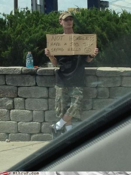 cardboard sign,hobo,homeless,job,not homeless,saying hello