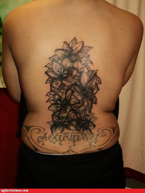 back tattoo,flowers,soakin wet