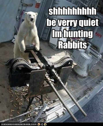 Funny meme of a polar bear at the helm of a large gun, with the caption of 'shhh, hunting rabits' as the punchline.