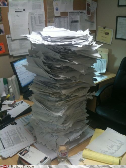 overtime paperwork stack of paper working overtime - 6233694464