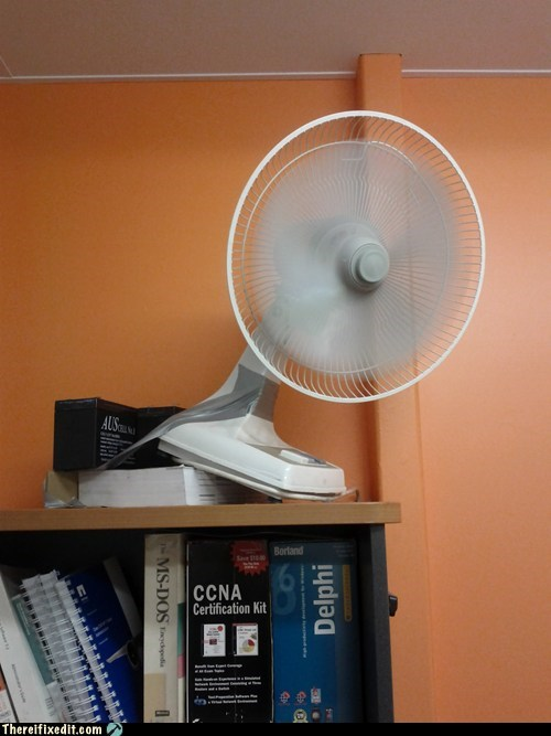 bookshelf,desk fan,fan,life on the edge