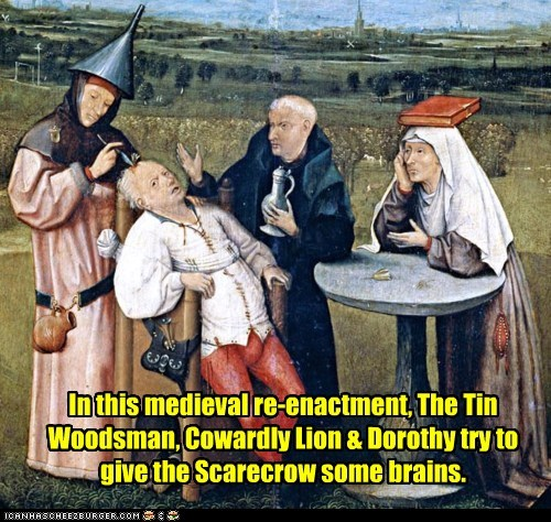 In this medieval re-enactment, The Tin Woodsman, Cowardly Lion & Dorothy try to give the Scarecrow some brains.
