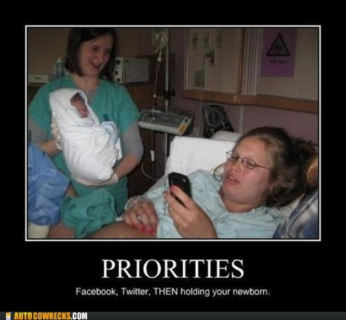 holding your newborn,priorities,tweeting it