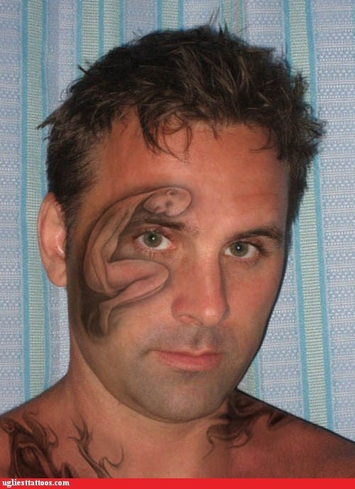 face tattoo fetal position man - 6257861888