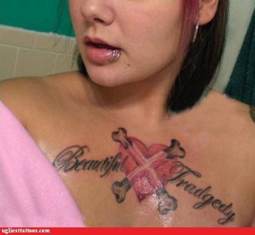 beautiful tragedy,cross bones,heart,misspelled tattoo