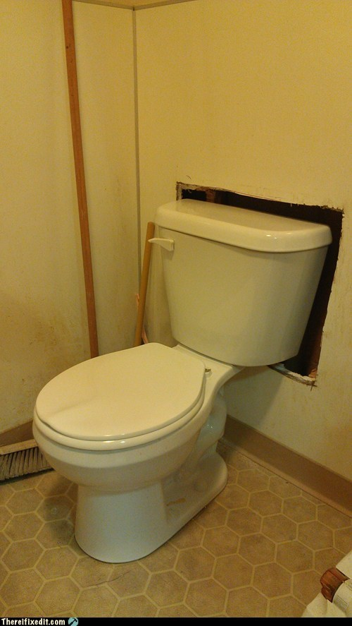 bathroom hole in the wall restroom tank toilet toilet tank wall - 6276514560