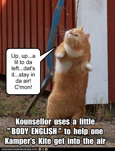 "Kounsellor uses a little "" BODY ENGLISH "" to help one Kamper's Kite get into the air Up, up...a lil to da left...dat's it...stay in da air! C'mon!"