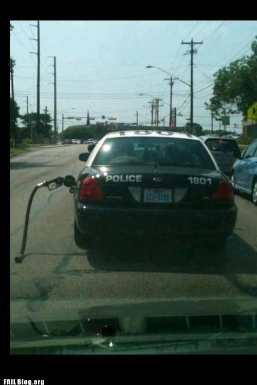 cop car,gas nozzle,gas station,police car