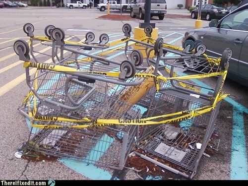 cart,caution,caution tape,fallen post,parking lot,post,shopping cart,Walmart,walmart parking lot