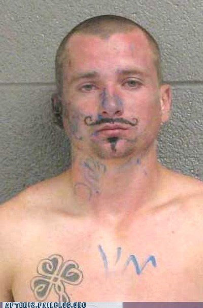 arrested,drawn on,jail,mugshot,mustache,police,prison