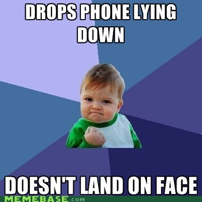 drop,face,lying down,phone,success kid