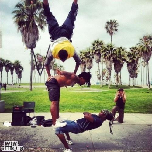 acrobatics balance dancing street performers stunt - 6333066496