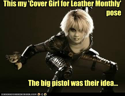 This my 'Cover Girl for Leather Monthly' pose The big pistol was their idea...
