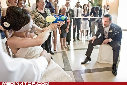 bride,funny wedding photos,groom,water gun