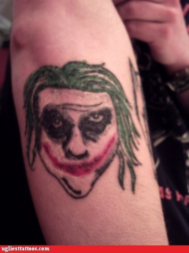arm tattoos,batman,joker