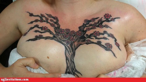 cleavage tattoos,flowers,tree