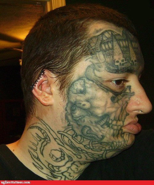body modification,ear stitches,face tattoos,skull