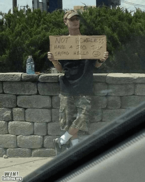 Not homeless, just saying hello funny picture of man holding a sign.