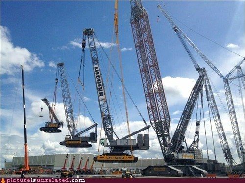 A crane lifting a crane, which is lifting a crane, which is lifting a crane