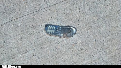 cell phone,cement,pavement