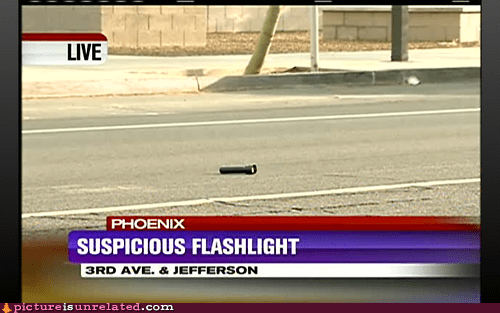 Screen grab of Phoenix news about a suspicious flashlight that was found in the street.