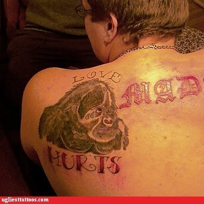 back tattoos,gorilla,love hurts
