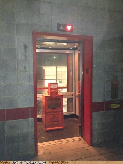 elevator IRL newspapers wtf - 6393156352