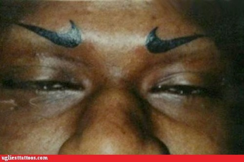 eyebrow tattoos,nike,swoosh