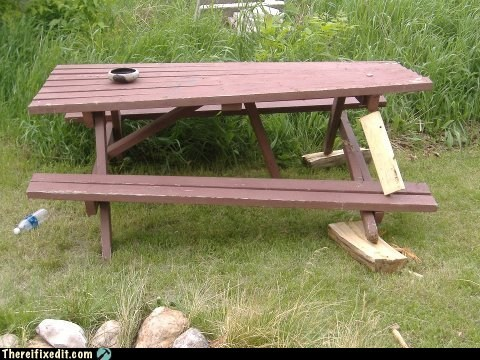 A sad day in the life of a picnic table.