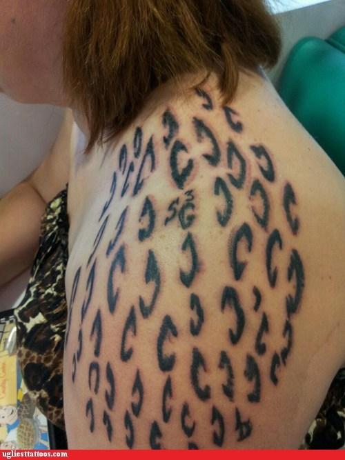 animal print,shoulder tattoos,spots