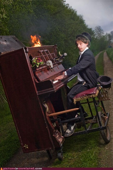 explosion,fire,one-man band,piano,wtf